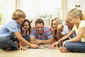 635993987158821338-2031569000_Family-Playing-Board-Game